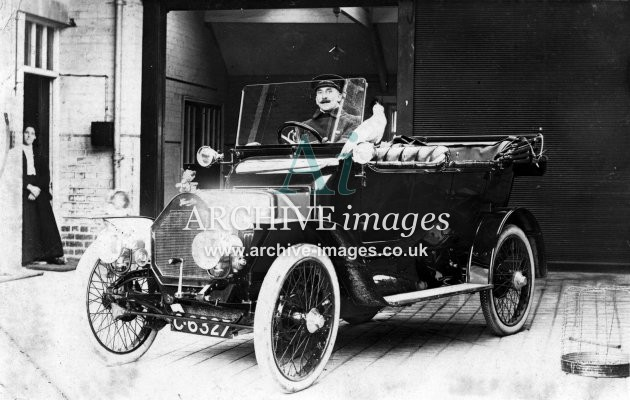 Motoring vintage car with parrot c1910 CMc