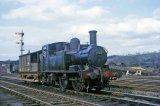 14xx 0-4-2T No. 1420 and GWR Toad brake van pose in Leominster Yard in April 1964