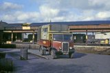 Fine study of a Parcels lorry (Reg. No. JXA 621) in BR maroon & cream livery at Gobowen station circa 1962