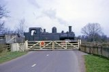 No. 1420 passing over a level crossing on the Kington Branch in May 1964. This may be Cobnash crossing again