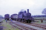 No. 1458 shunts the yard at Kington watched by two small boys on 25th April 1964.