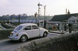 St Blazey crossing closed to traffic as a china clay train is shunted circa 1972. This line leads into Par Harbour. Nice Beetle!