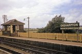 Okehampton signal box and one of the station nameboards circa 1965