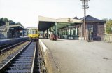 Okehampton station in 1971, with a DMU on an Exeter train at the platform