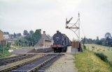 Fowler Class 4F 0-6-0 No. 44560 pauses at Cole station with the 4.15pm train from Templecombe to Bath on 13th July 1962