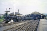Fowler Class '4F' No. 44544 and BR Standard 4-6-0 No. 75009 wait to leave Bath Green Park station with the 9.15am to Templecombe on 13th March 1962
