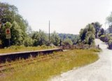 The derelict platform and level crossing at Bronwydd Arms in June 1974. Note: Photo taken with a 110 camera. The neg has deteriorated beyond use and the print is on a mottled surface photo paper, so this scan is the best we can achieve.