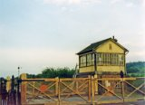 Sarnau Signal Box and level crossing, west of Carmarthen, in June 1974. Note: Photo taken with a 110 camera. The neg has deteriorated beyond use and the print is on a mottled surface photo paper, so this scan is the best we can achieve.
