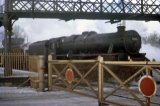 No 44835 departs Llandovery over the level crossing in 2.1963